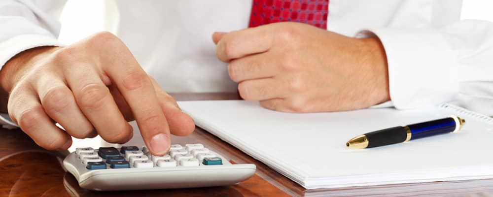 Man with calculator and finance papers