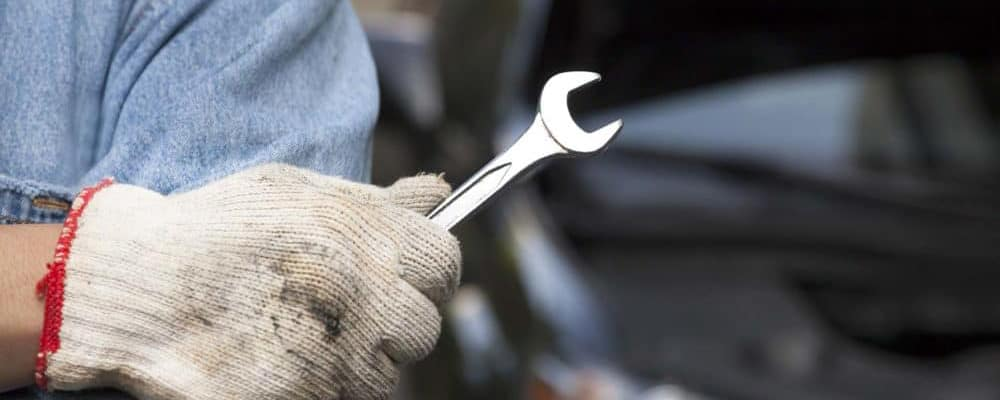Man-with-glove-holding-a-wrench_15331853_xl-2015-11-e1545084029550 copy