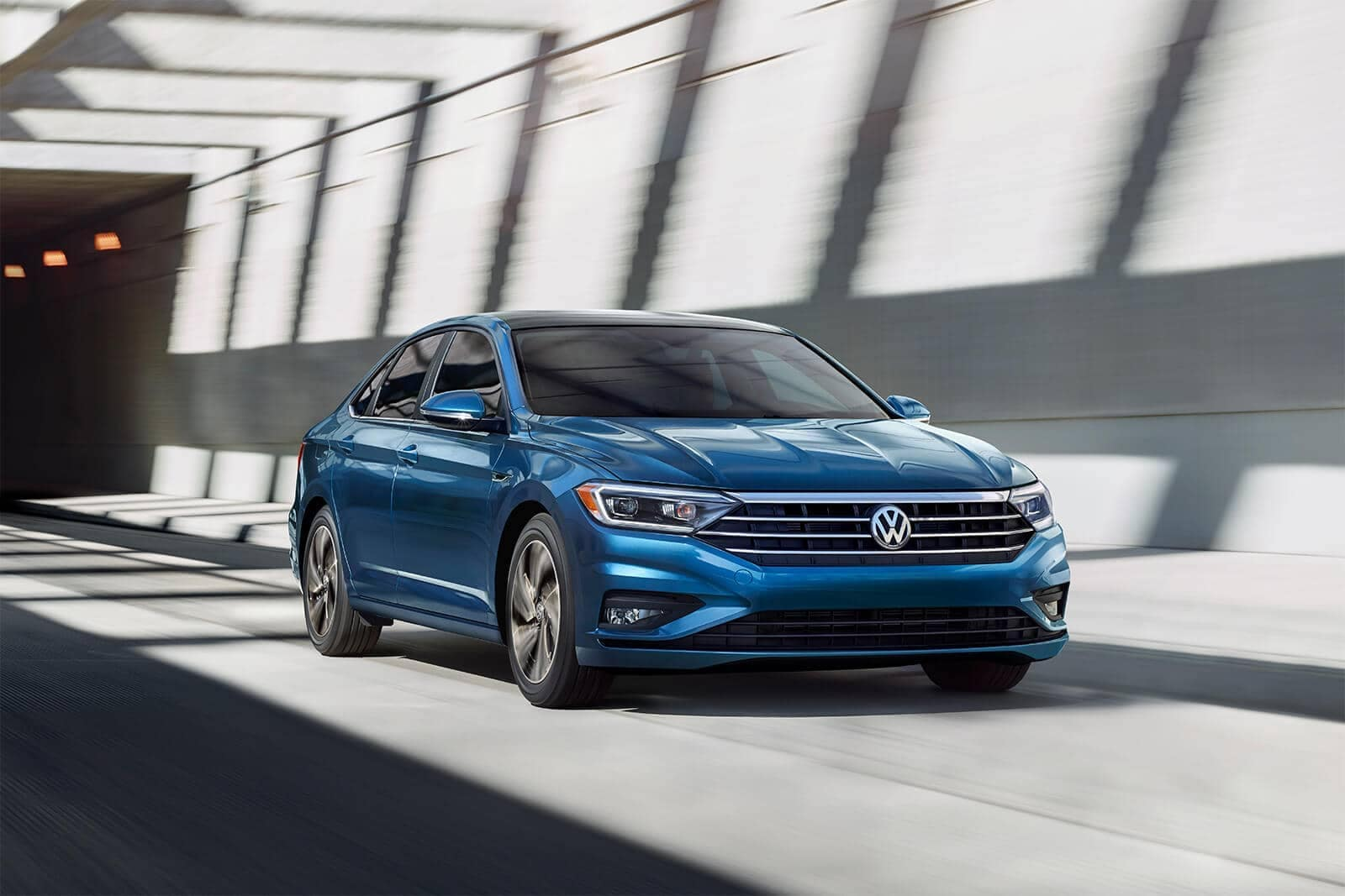 2019 Jetta SEL premium in silk blue metallic driving