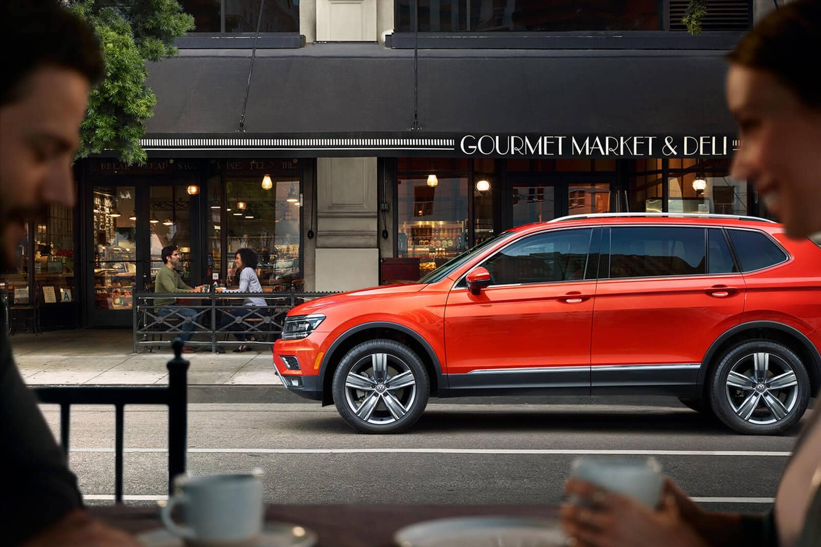 2019 Volkswagen Tiguan in front of shop