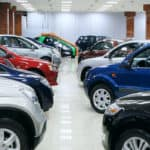 New fuel efficient SUV's on a car dealers lot for sale.
