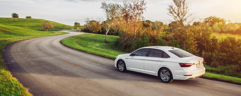 2021 Volkswagen Jetta driving down city road