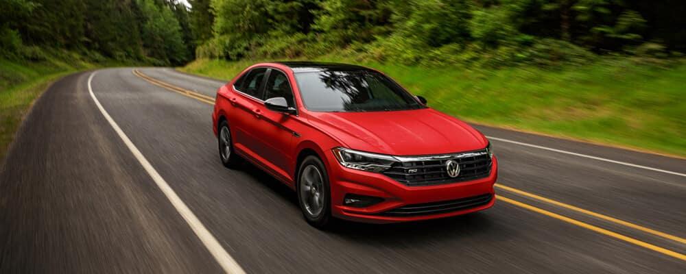 2021 Volkswagen Jetta racing down wooded road