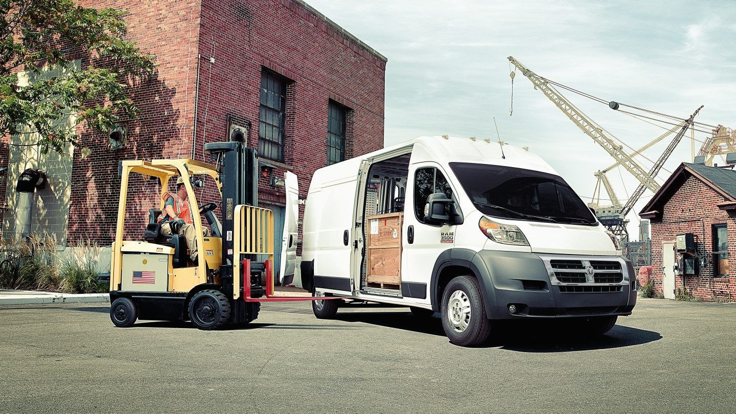 2017 Ram ProMaster being loaded by forklift