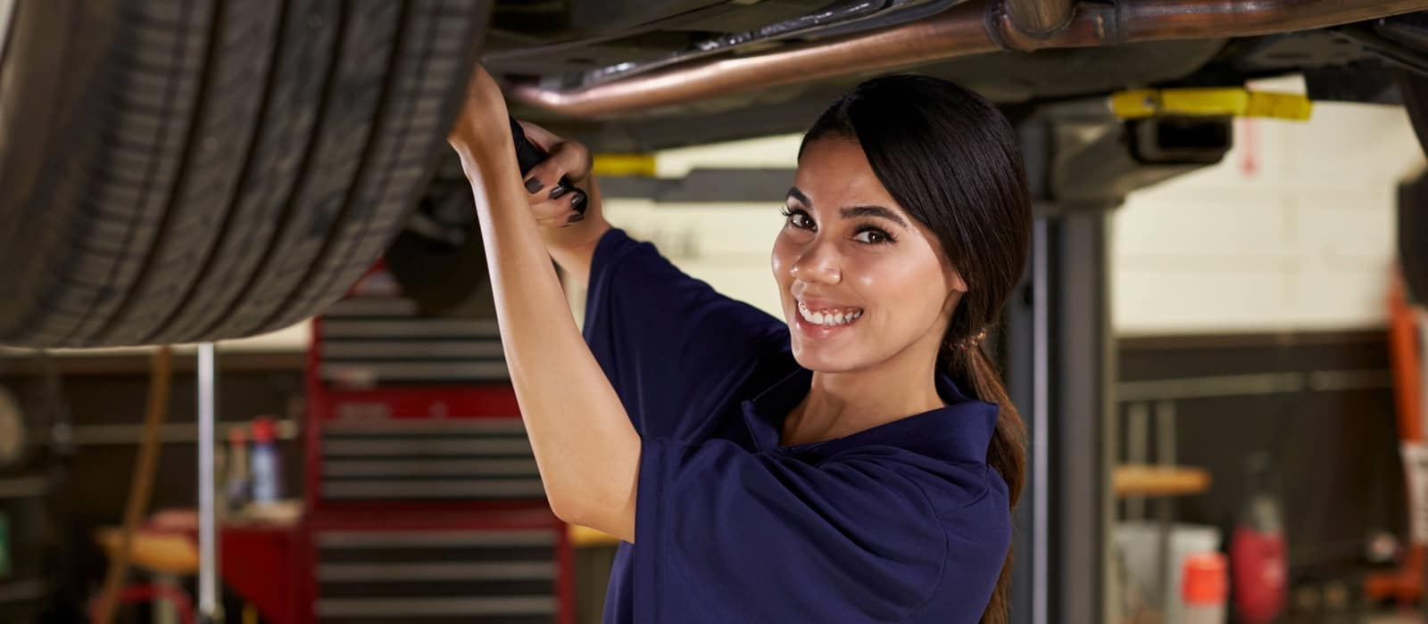 female mechanic fixing a vehicle