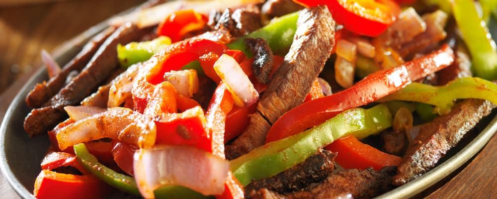 Beef fajitas on a sizzling plate