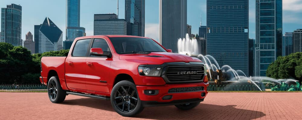 2020 Ram 1500 red near city scape