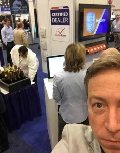 Jay Mealey takes a celebratory selfie while the Dealers of the Year were announced at NADA 2015.