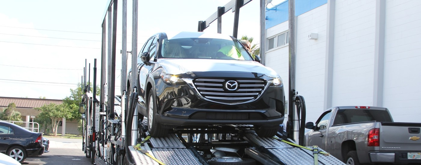 2016 Mazda CX-9 rolling off the delivery truck at Sport Mazda in Orlando, FL