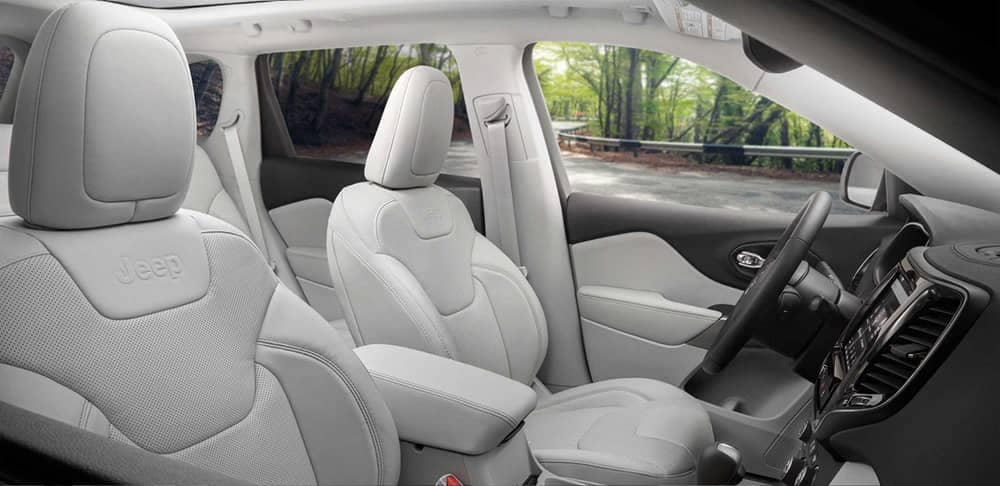 2019 Jeep Cherokee interior cabin with white seats