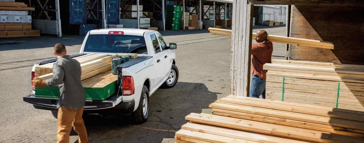 2 Men loading wood into bed of 2018 Ram 1500