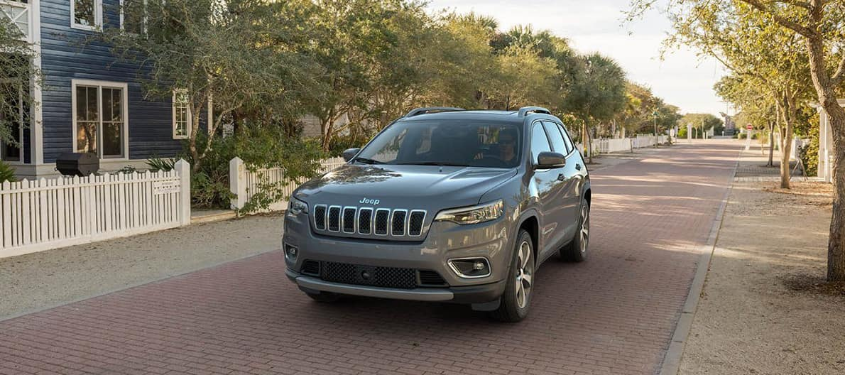 man drives 2019 Jeep Cherokee on residential street