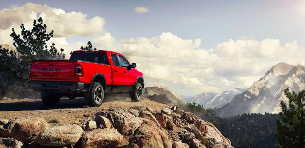 Red 2019 RAM truck parked on a cliff