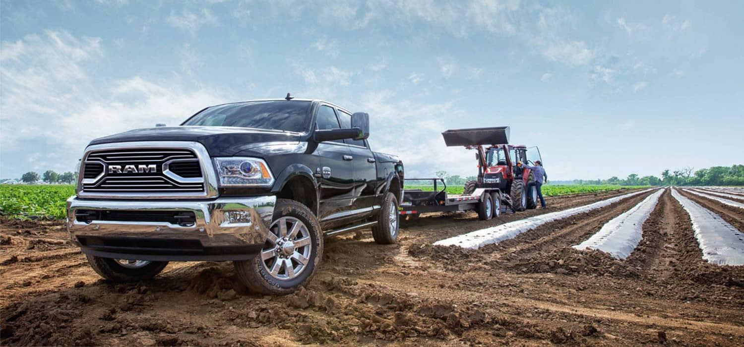 2018 RAM 2500 Laramie Longhorn Towing Tractor on farm