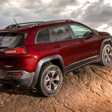 2018 Jeep Cherokee going up dirt mountain
