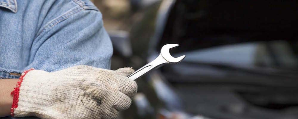 Car technician holding the wrench