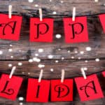 Happy Holidays banner on rustic wood background
