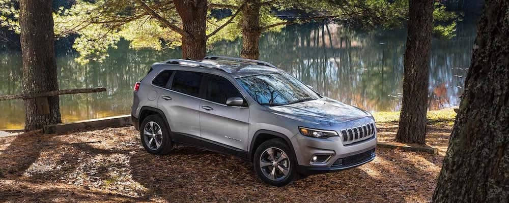 2019 Jeep Cherokee in woods by lake