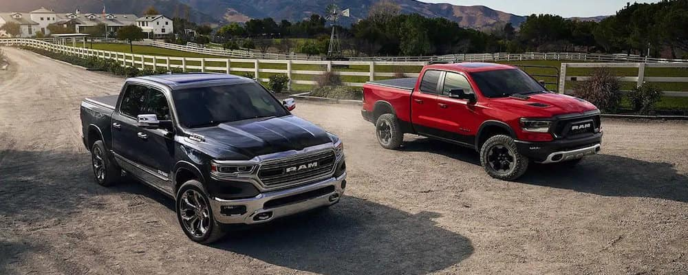 Two RAM Pickup Trucks side-by-side on farm