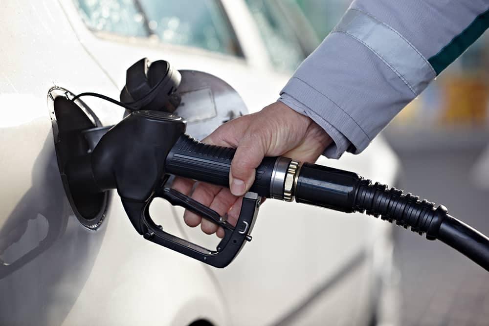 Someone pumping Gas