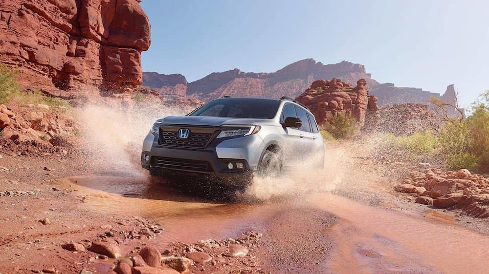 2019 Honda Passport driving in the mud