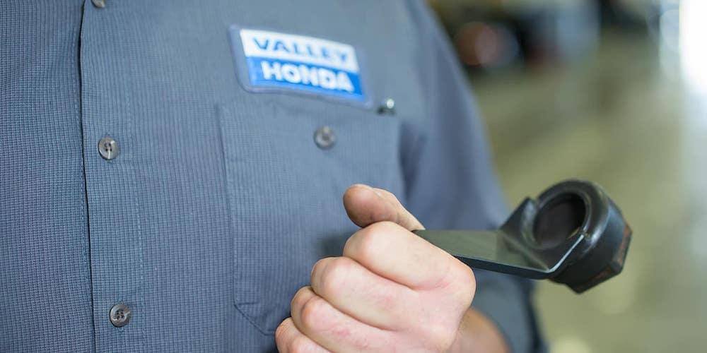 Valley Honda Technician Holding Tool
