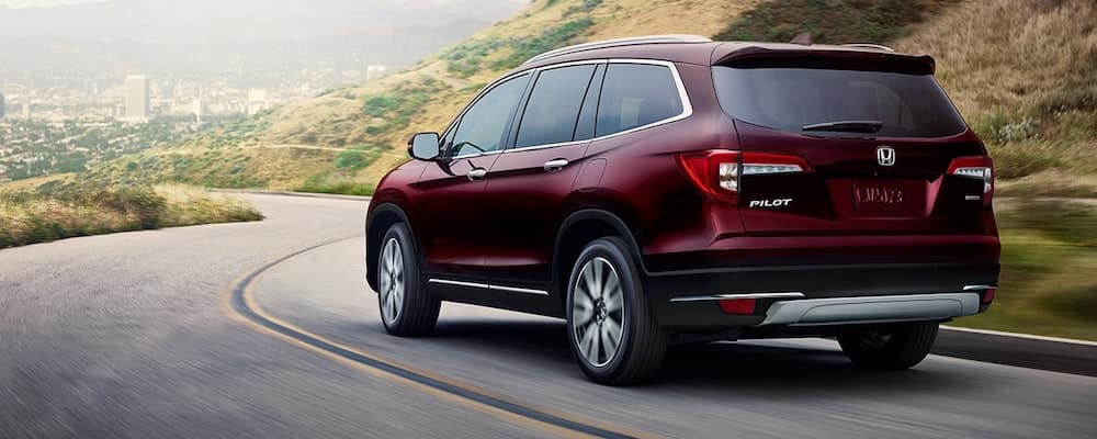 Red 2020 Honda Pilot on Highway Corner