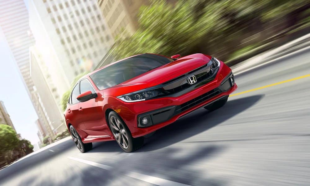 Red 2019 Honda Civic on City Street