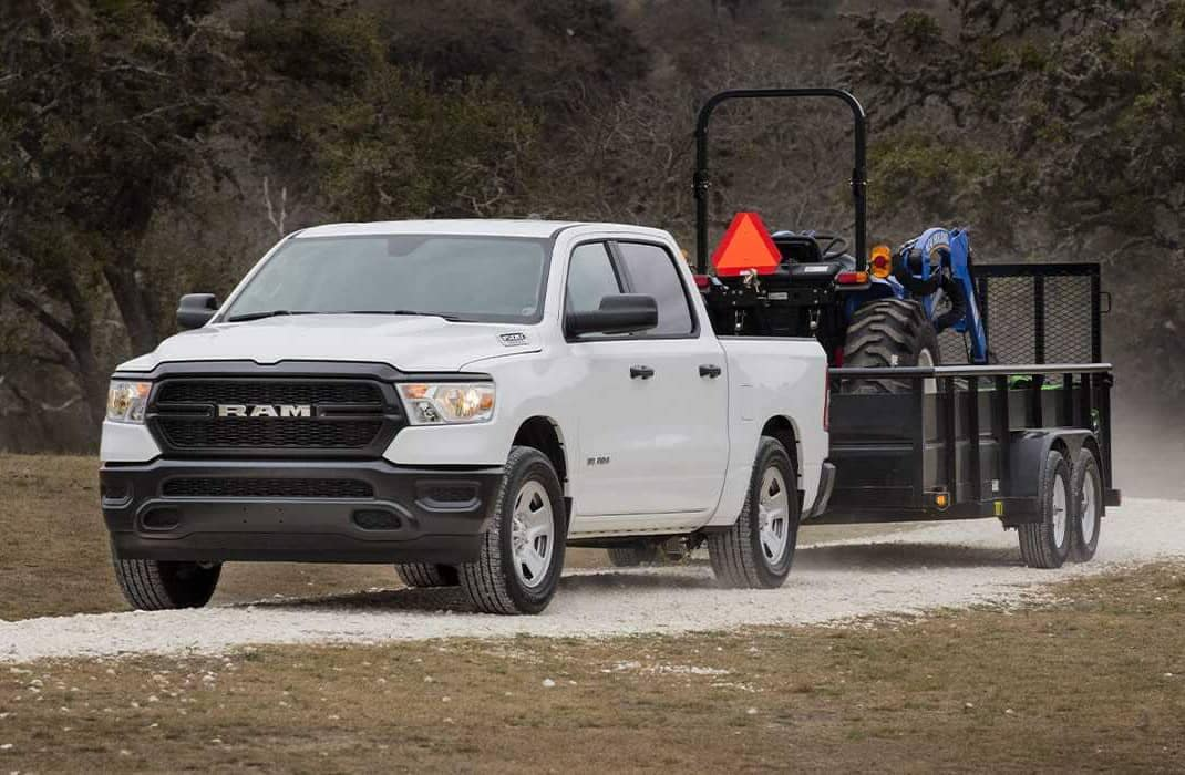 2019 RAM 1500 tows trailer with farm equipment