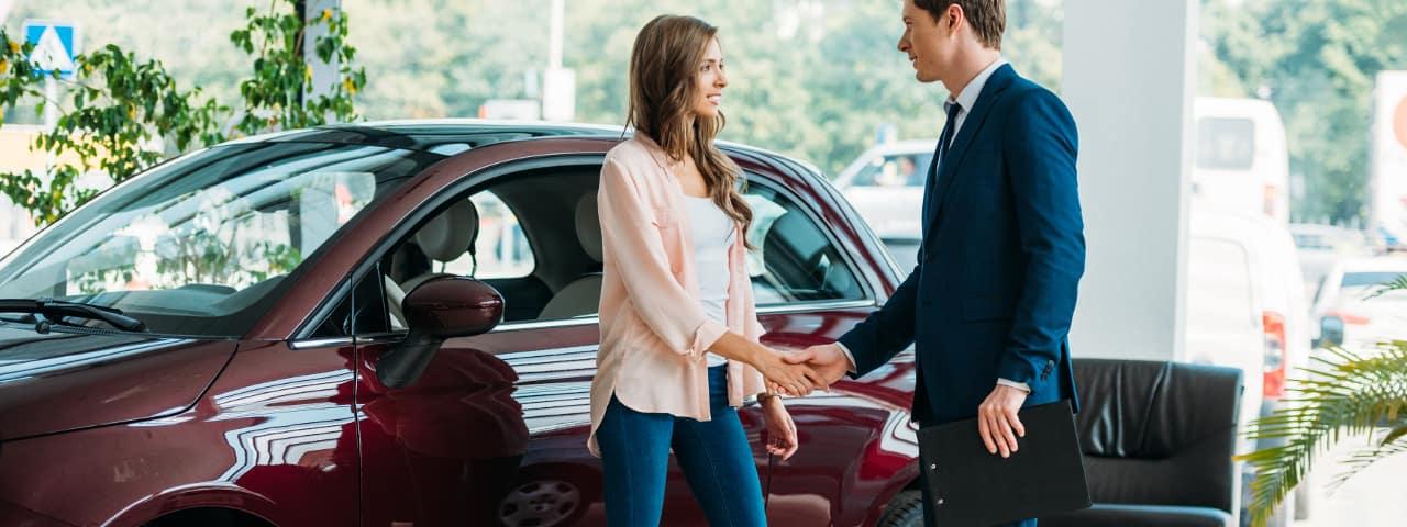 woman saying hi to dealer salesman
