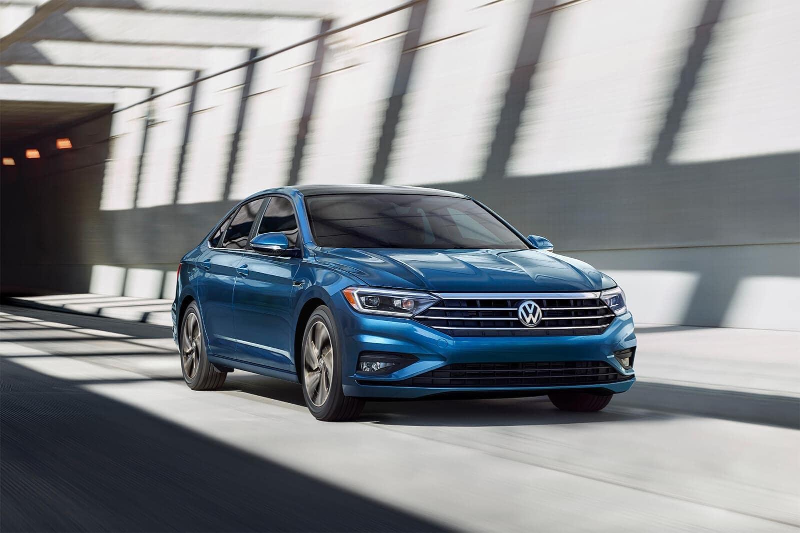 2019 Volkswagen Jetta in Silk Blue Metallic Driving on Road