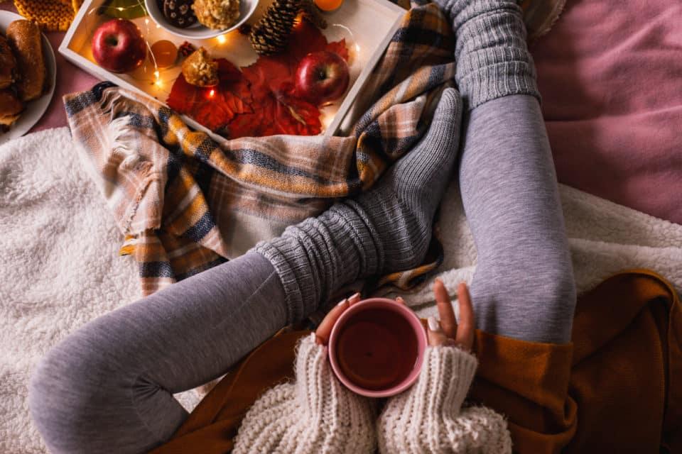 Woman drinking tea in a fall home decor setting