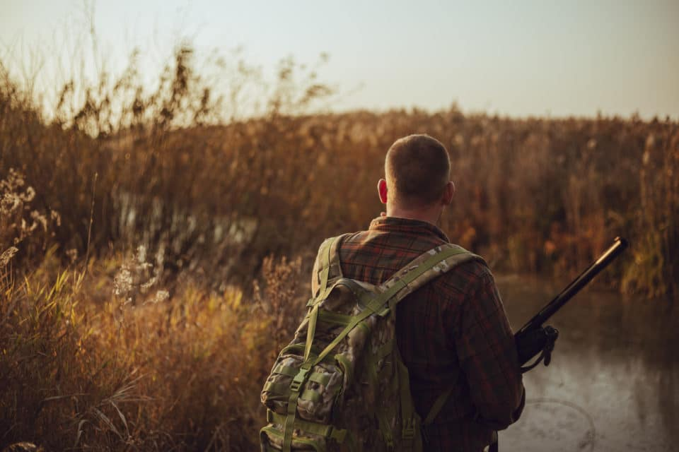 Man with military backpack hunting