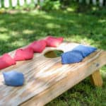 red and blue bags on hommade wood cornhole board