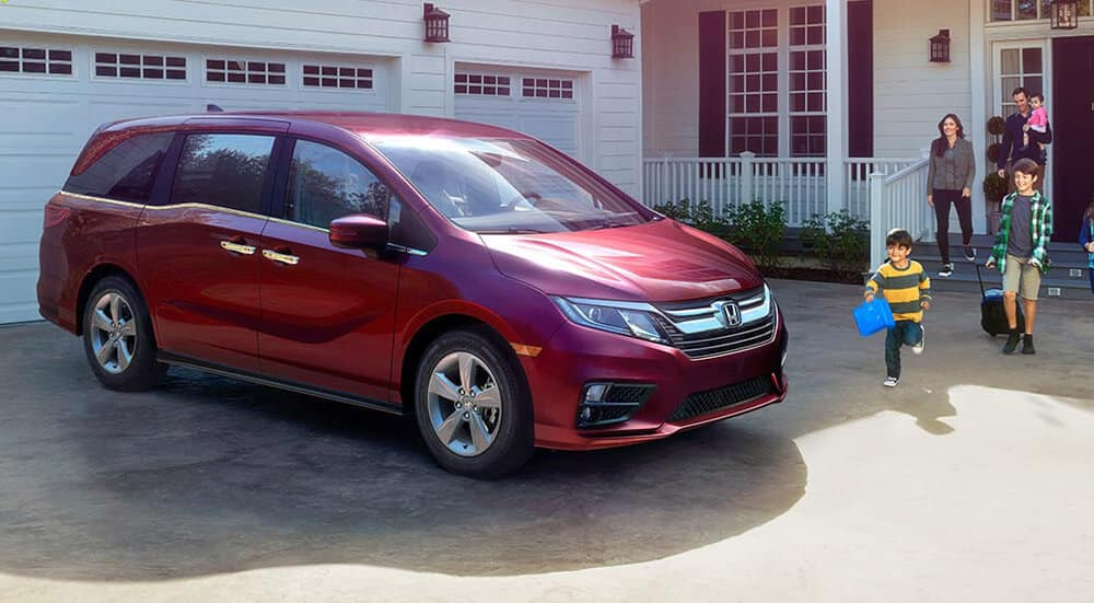 2018 Honda Odyssey parked outside a home