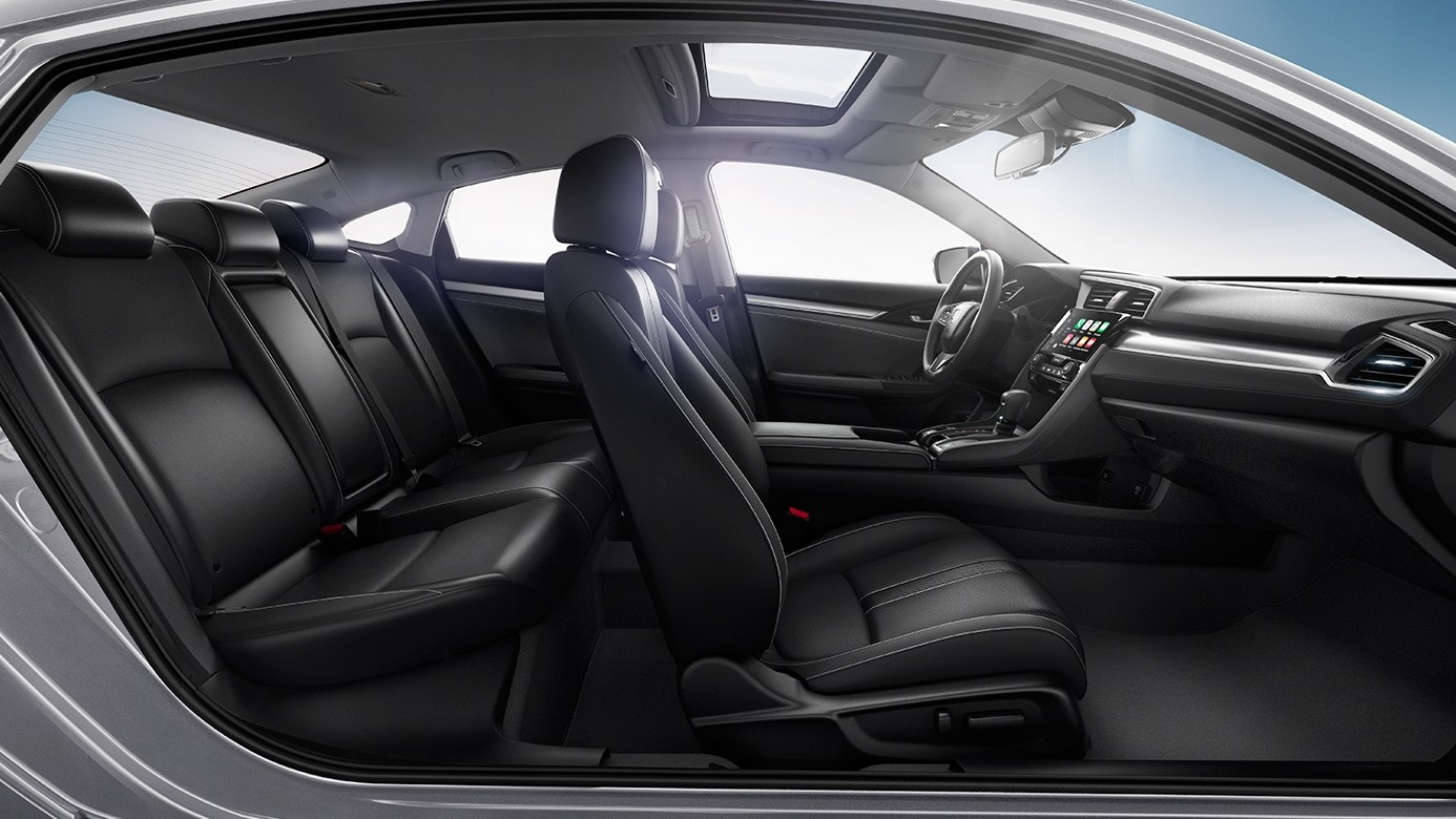 Interior Shot of the 2017 Honda Civic Showing the Front and Rear Seats from the Side