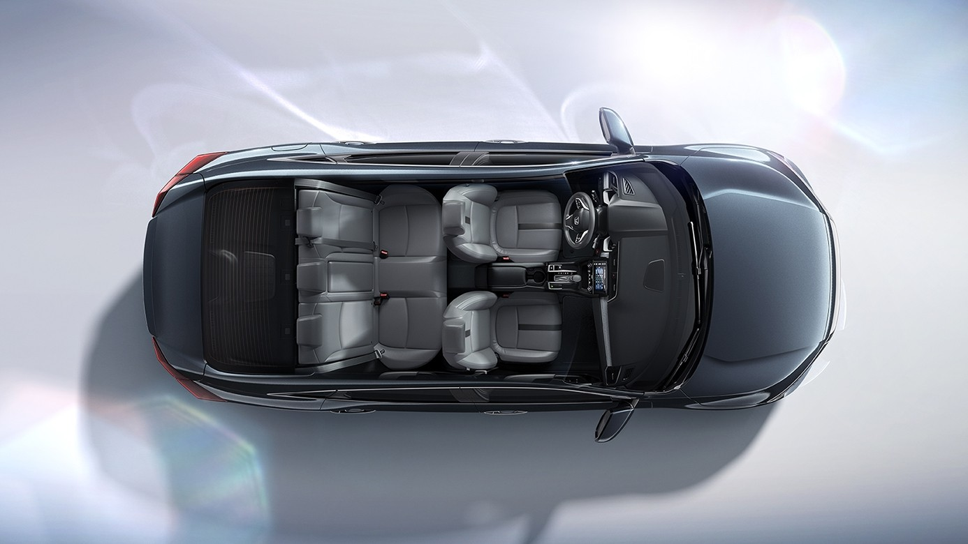 Interior of the 2017 Honda Civic Taken from Above with the Roof Removed Showing on a Light Gray Background