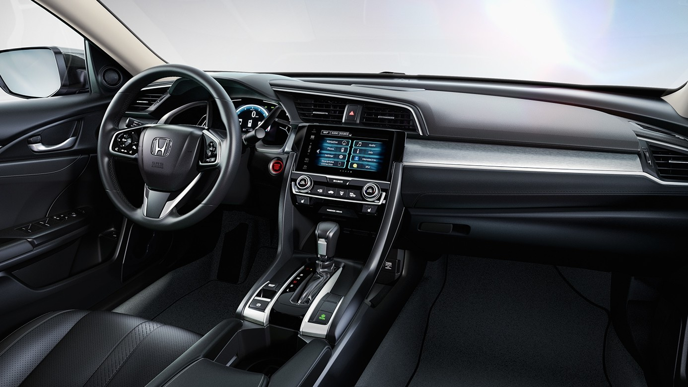 Interior Shot of the 2017 Honda Civic Showing the Dashboard and Driver's Side Door