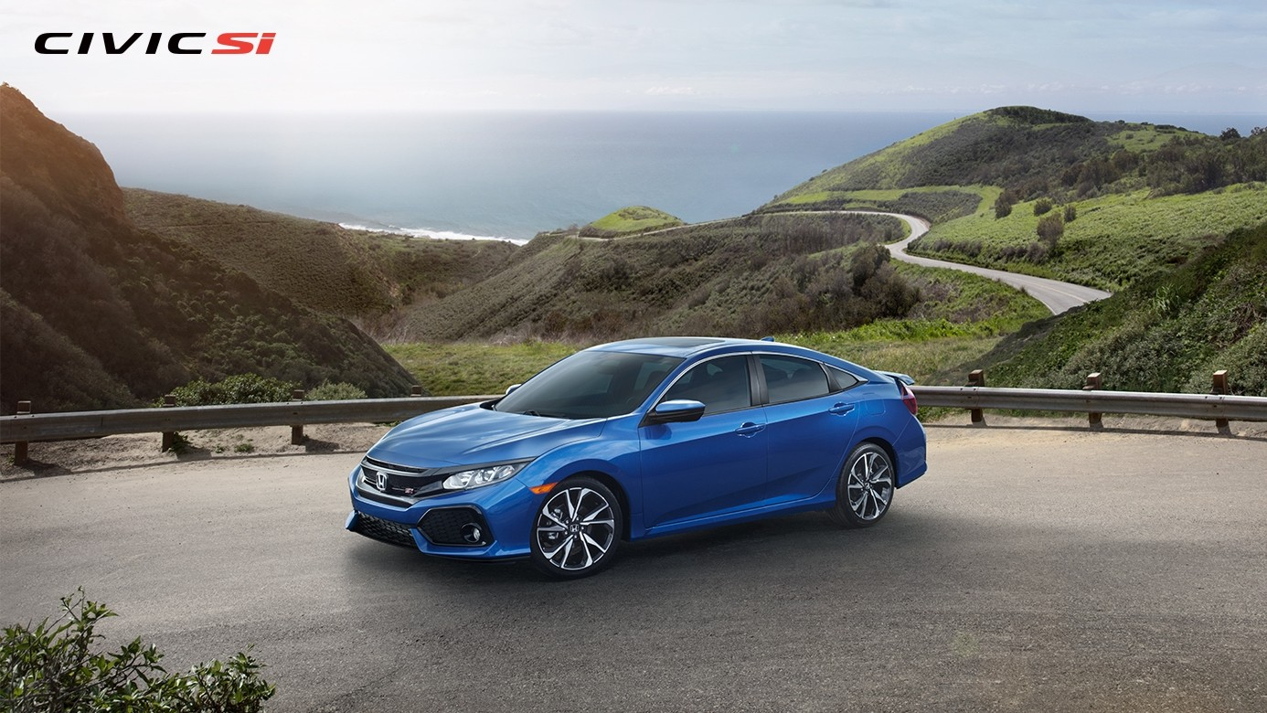 Side View of the 2017 Honda Civic Si Parked on the edge of a Mountain Pass with Forested Mountains and the Ocean in the Background