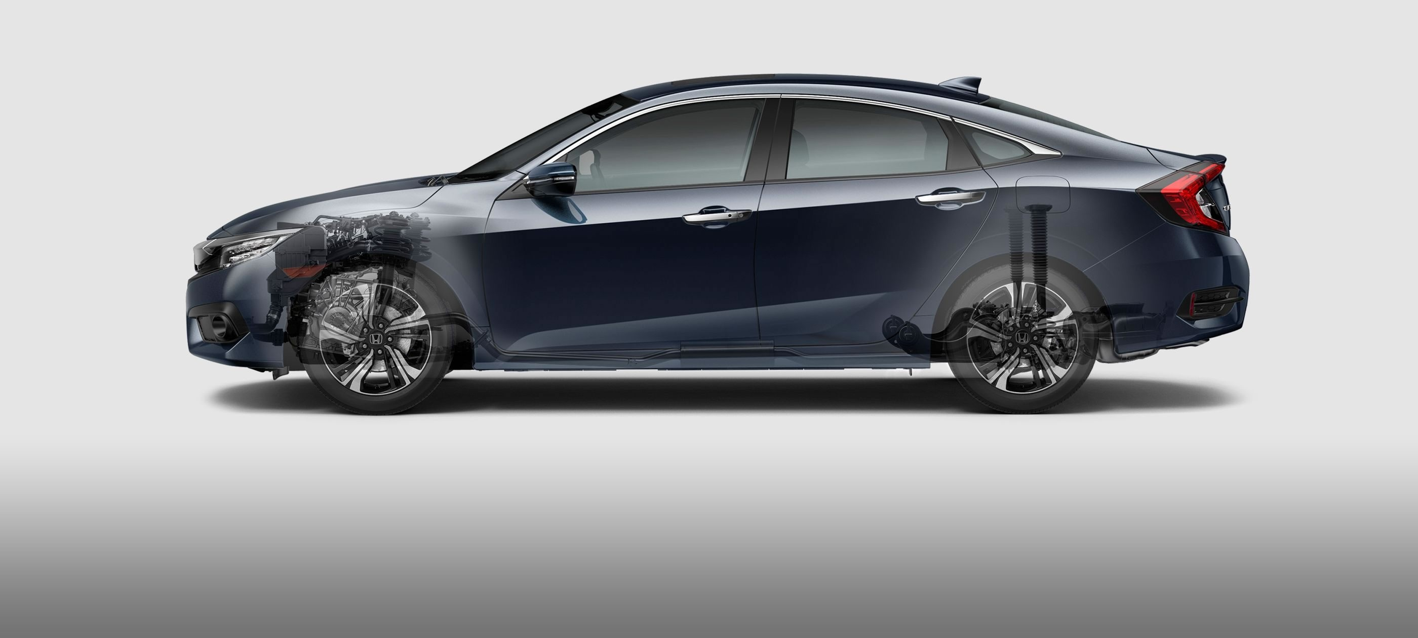 Transparent Side View of the 2017 Honda Civic Showing the Suspension and the Engine