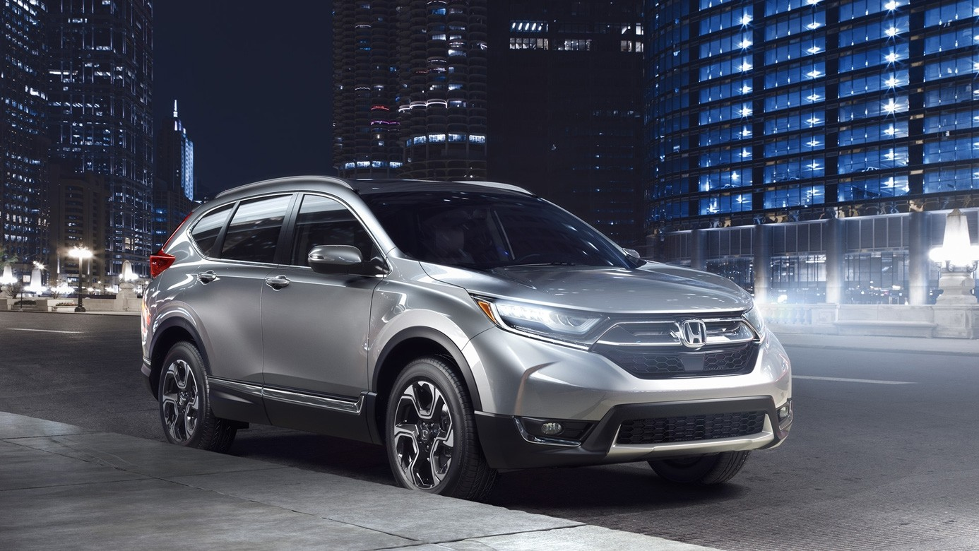 2017 Honda CR-V Side View in front of a City at Night