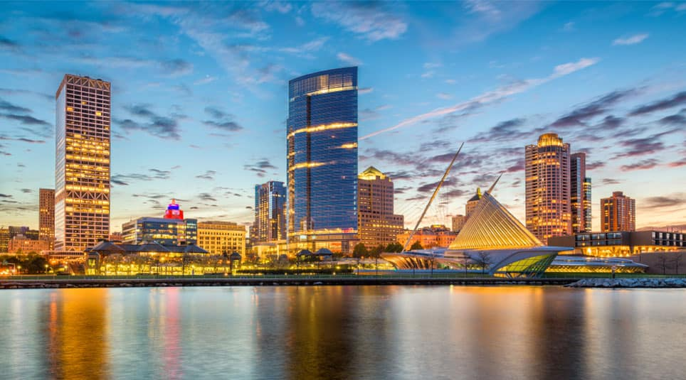 The skyline of Milwaukee is shown at dusk.