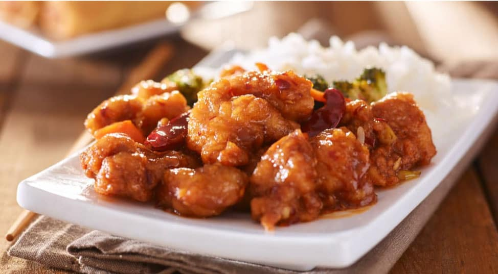 A plate of General Tso's Chicken and rice is shown.