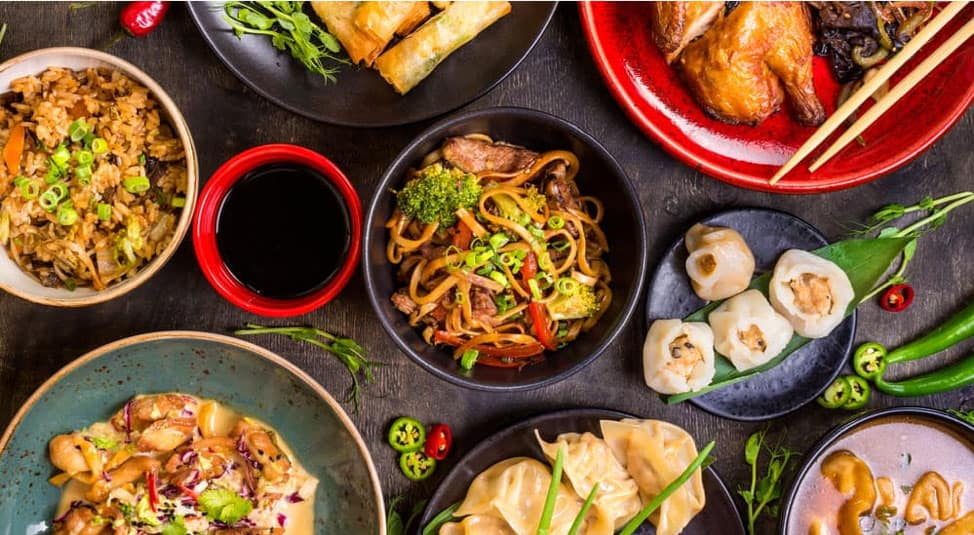 A table filled with Chinese food from a Milwaukee, WI, restaurant is shown.