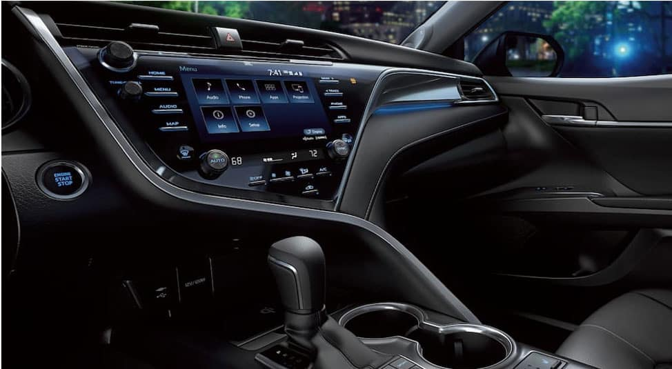 The Entune system is shown in the black interior of a 2019 Toyota Camry.