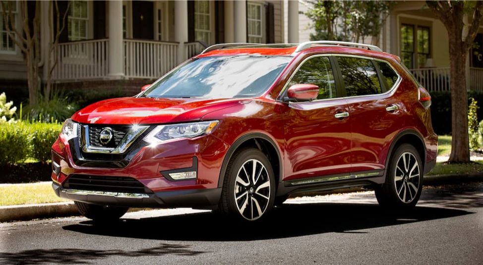 A red 2019 Nissan Rogue is parked on the street in front of a house near Milwaukee, WI.